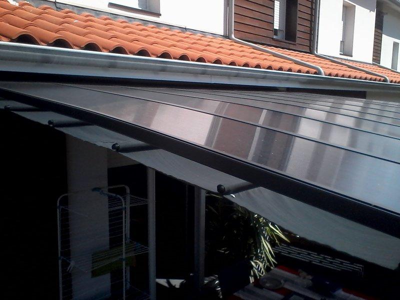 toit en polycarbonate et  terrasse couverte 2