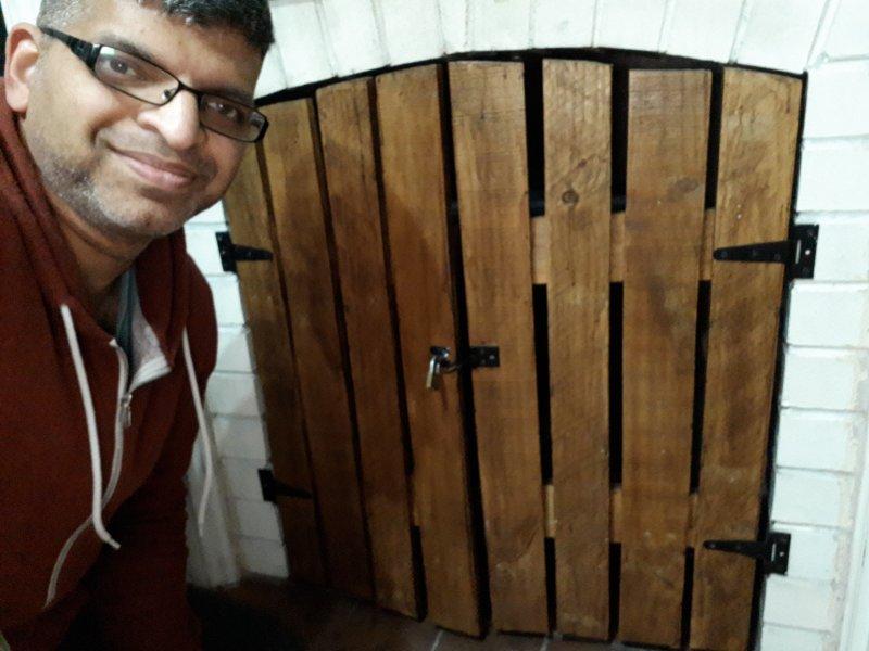 DIY fireplace door from pallet wood