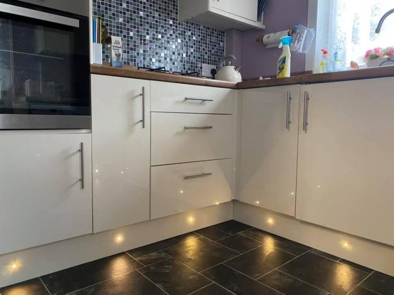 Fully fitted kitchen with plinth lighting