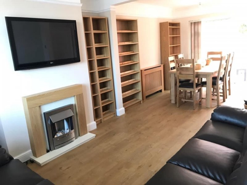 Laminate flooring, building of storage, decoration and installation of fire place